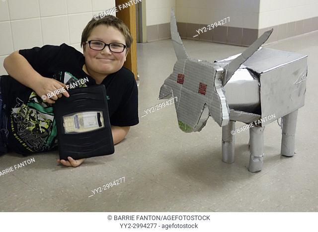 6th Grade Boy Showing Off Robot, Wellsville, New York, USA