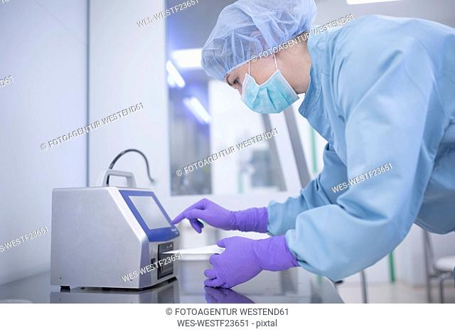 Scientist working in laboratory for drug production