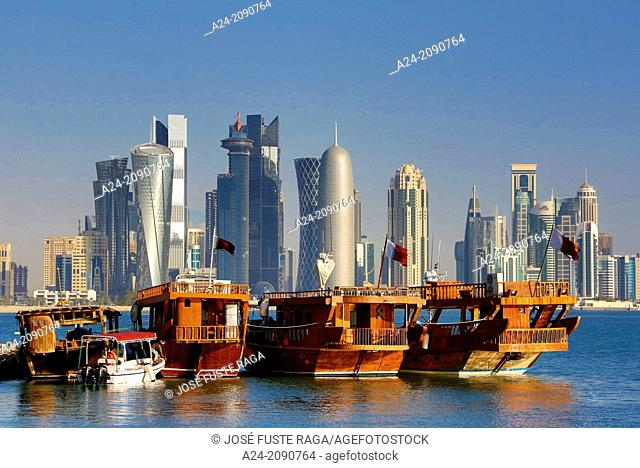 Qatar , Doha City, traditional boats and West Bay Skyline