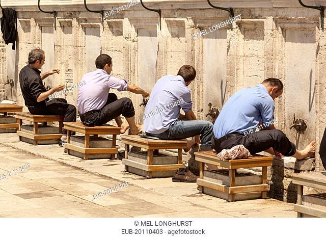 Men washing their feet in preparation for prayers at Suleymaniye Mosque