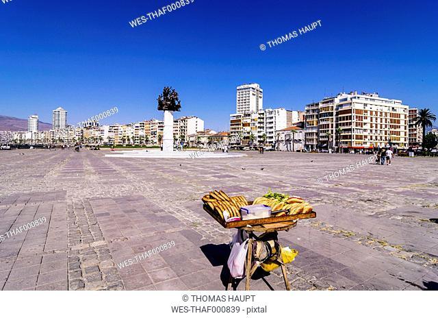Turkey, Izmir, Aegean Region, Cumhuriyet Square, Atatuerk Memorial, Stall with pastry in the foreground