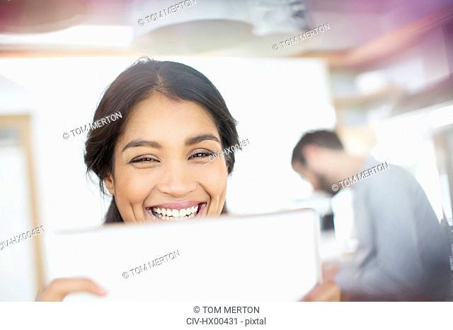 Close up portrait smiling woman using digital tablet