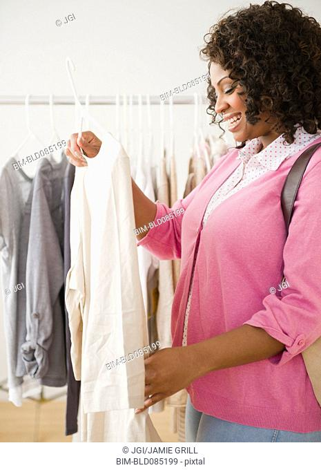 African American woman shopping for clothing