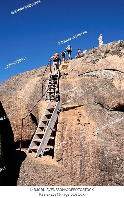 Hikers climbing Mount Dunn in Mount Buffalo National Park. Victoria, Australia