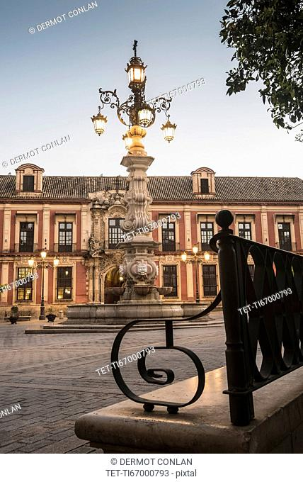 Spain, Seville, Plaza Virgin De Los Reyes, Town square at dusk