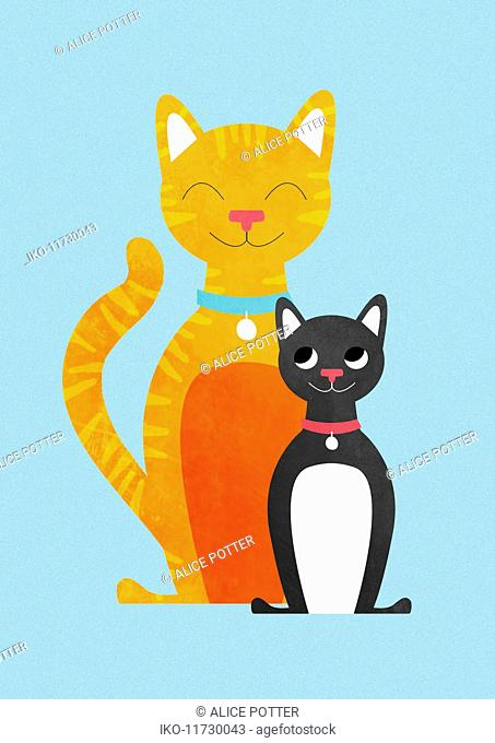 Two happy cats sitting side by side