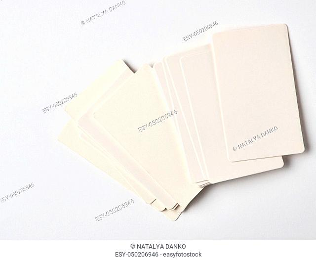 stack of blank rectangular paper white business cards on a white background, top view