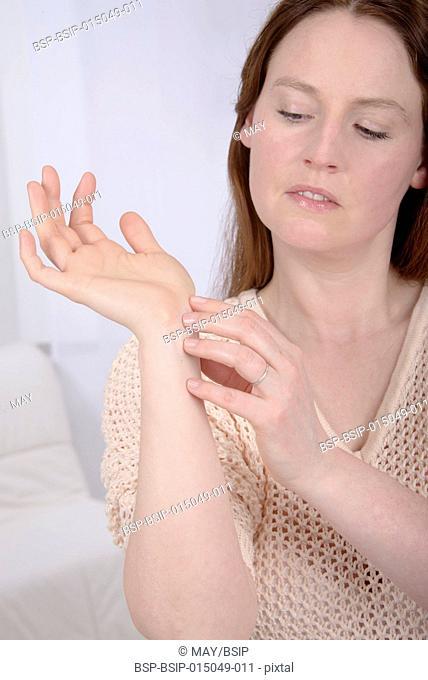 Woman scratching