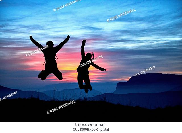 Hikers jumping for joy, Manigod, Rhone-Alpes, France