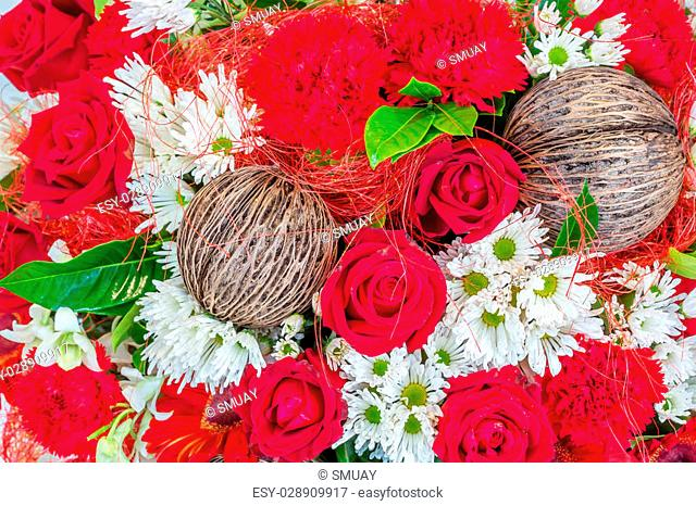 Flowers arrangement with red rose and carnation