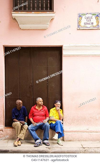 Cuba - Three pensioners observing street life in Habana Vieja, the Old Town of Cuba's capital Havana