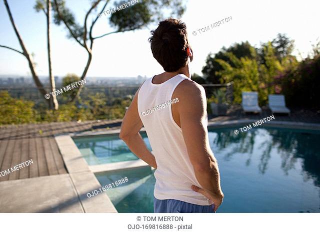 Man standing near swimming pool