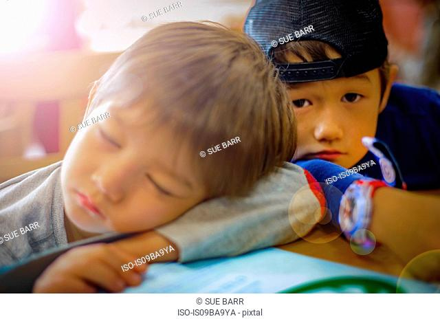 Portrait of boy and sleeping brother