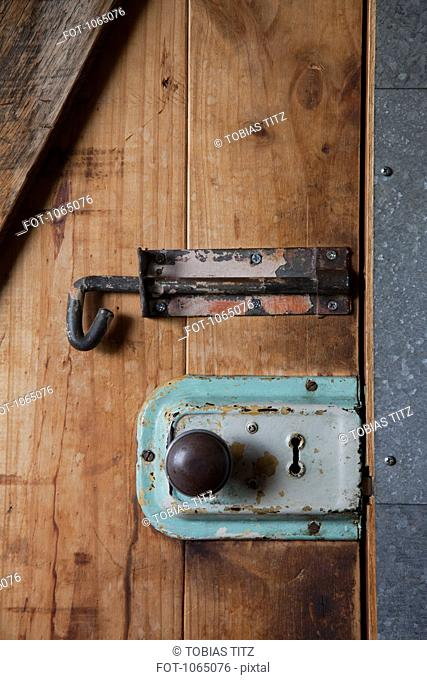Two old-fashioned locks on a wooden door