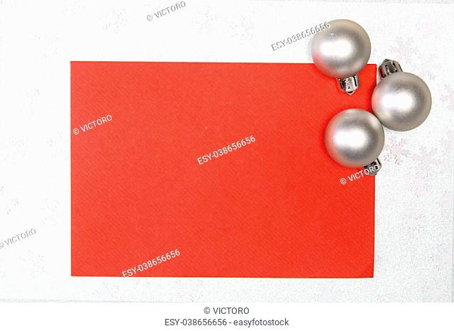 card with chritmas balls on silver snowflakes background