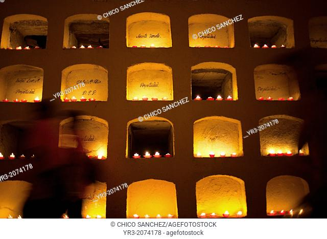 Candles decorate graves of the San Miguel cemetery during the Day of the Dead celebrations in Oaxaca, Mexico. The Day of the Dead celebration is a tradition...