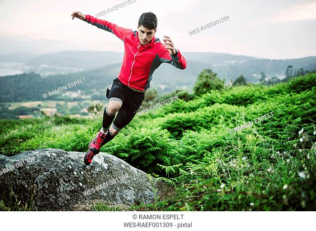 Trail runner man training in nature in the evening