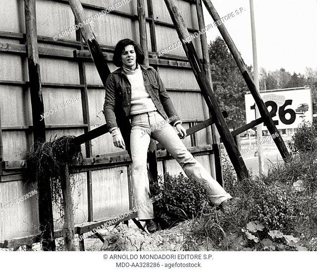 Claudio Baglioni. Claudio Baglioni poses standing for the photographer in the open air; the singer-songwriter of Rome has success in 1972 with the song 'Questo...