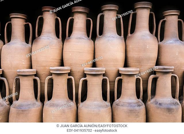 Ancient roman amphorae stored at hold ship as ancient times trade. Isolated over black