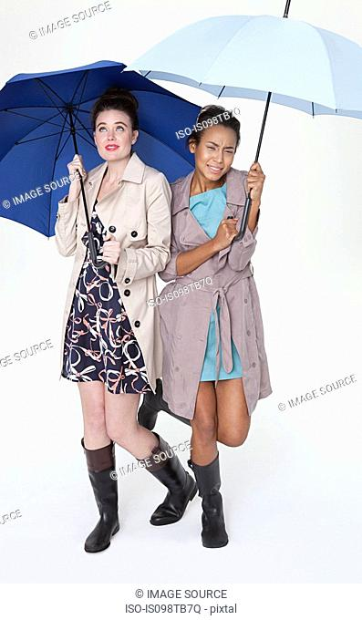 Young women under umbrellas