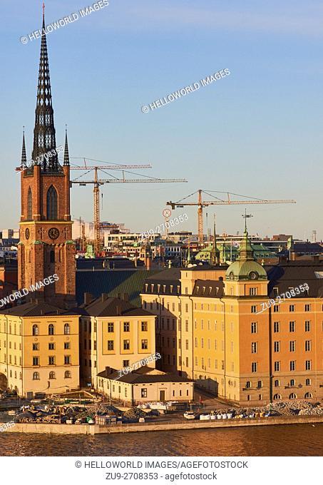 Riddarholmskyrkan on Riddarholmen island and urban landscape with cranes, Stockholm, Sweden, Scandinavia