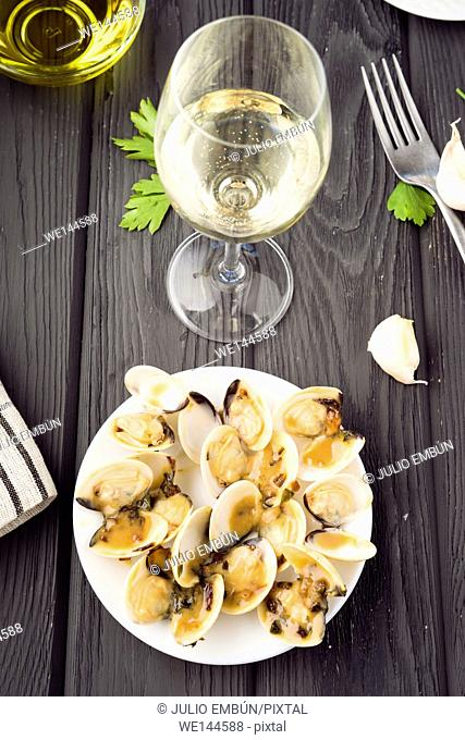Pacific clams cooked in sauce and glass of wine
