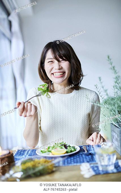 Young Japanese woman eating salad