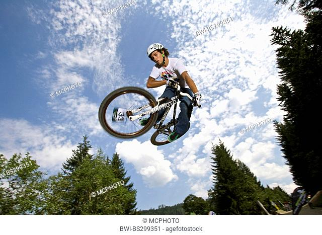 teenager jumping with a mountain bike, Austria