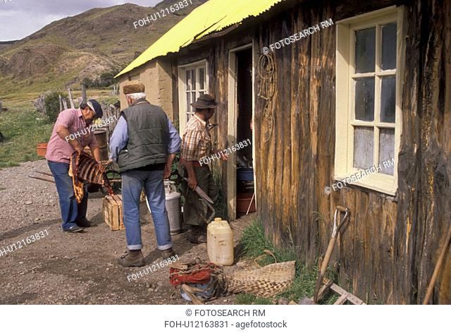 expedition, Patagonia, Argentina, Men picking up supplies in an old shed for a hiking expedition in the Fitzroy Mountains (Cerro Fitzroy) in Parque Nacional de...