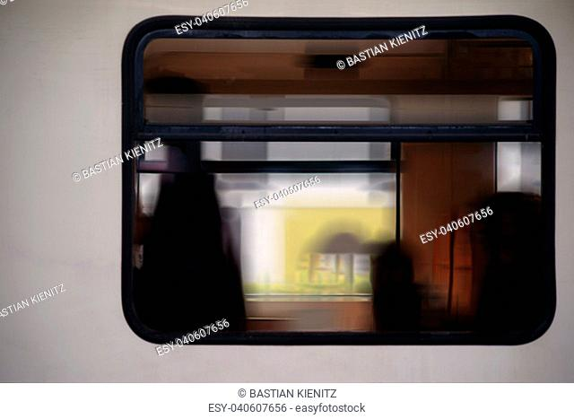 silhouettes in the train window