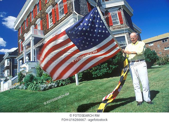 Man Raising American and Maryland Flags, Cape May, New Jersey