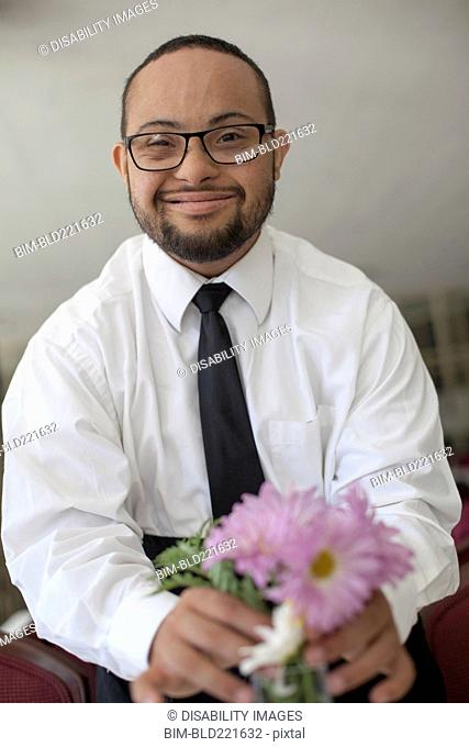 Mixed race man arranging flowers