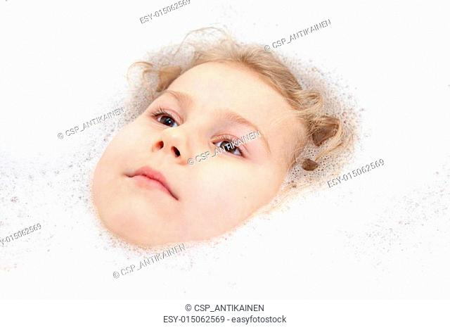 Children Caucasian face in white soap