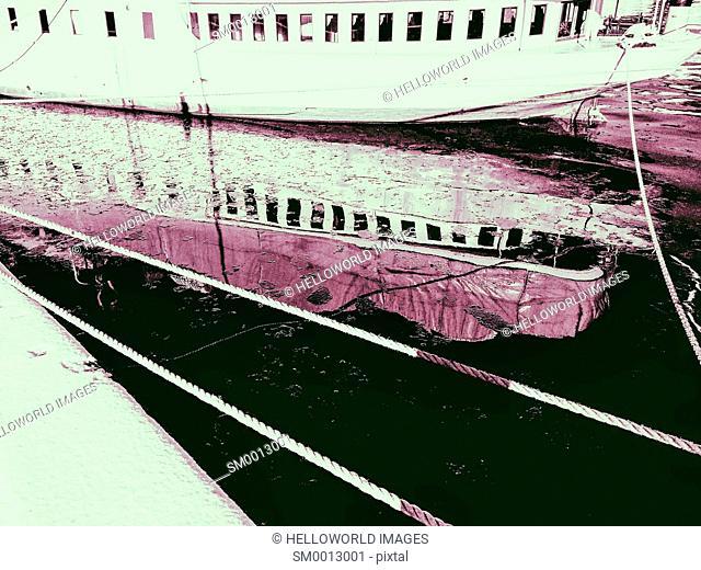 Moored boat and reflection, Stockholm, Sweden, Scandinavia