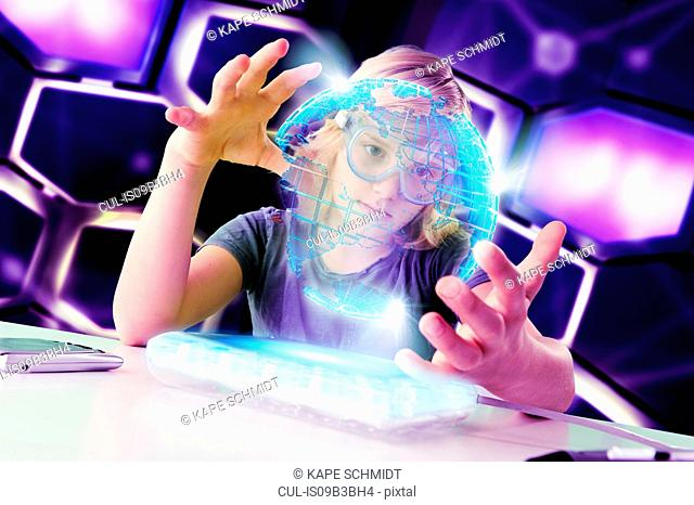 Boy interacting with floating digital globe