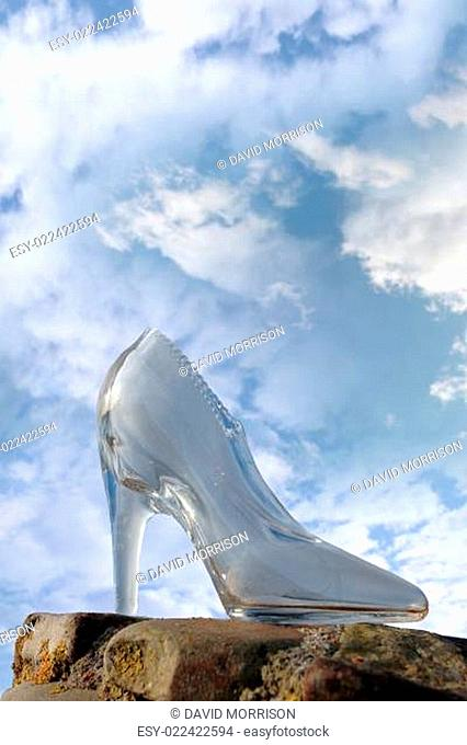 glass high heel shoe on rocky stone surface
