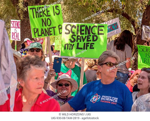 Women with protest signs at rally for Science on Earth Day, 22 April 2017, in Tucson, Arizona, USA. No model release