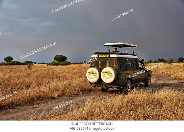 4x4 tourist vehicle in landscape in Queen Elizabeth National Park, Uganda, Africa - Uganda, 13/02/2015