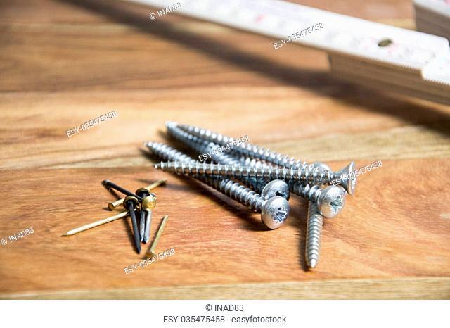 screws on wooden background