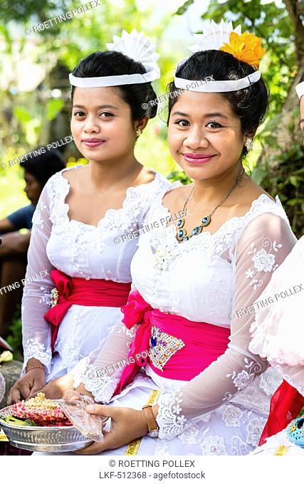 Two women at a Odalan temple festival, Sidemen, Bali, Indonesia