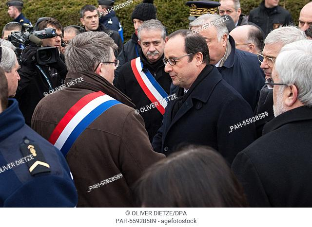 French President François Hollande welcomes city delegates during a commemoration at a Jewish cemetery in Sarre-Union, France, 17 February 2015