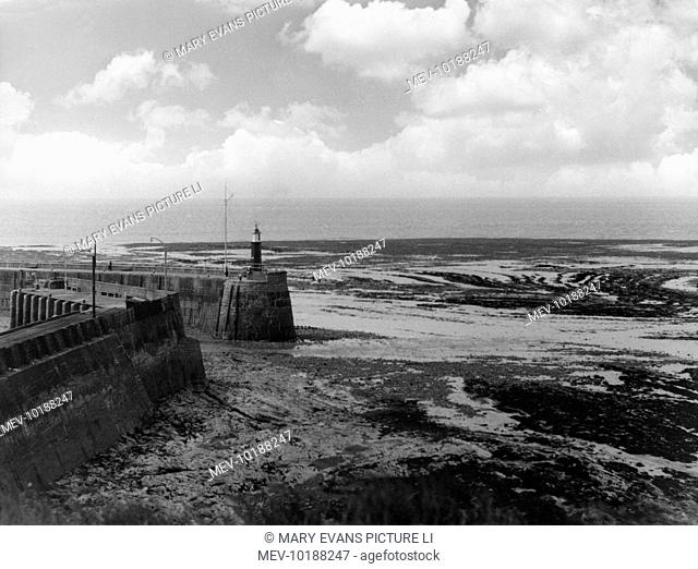 Ebb tide, a low water view of the harbour mouth at Watchet, on the south coast of Somerset, England