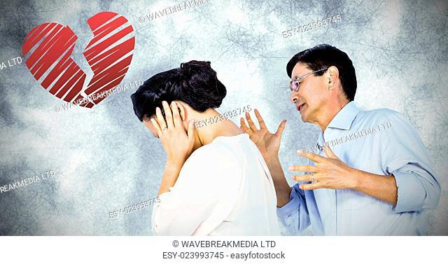Older asian couple having an argument against red heart