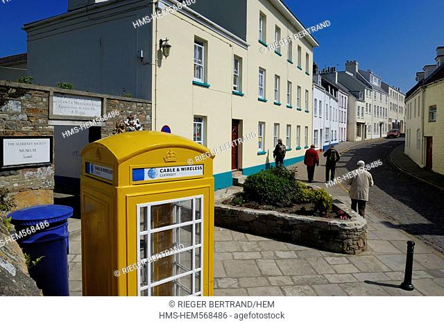 United Kingdom, Channel islands, Alderney, town of St Anne, typical telephone box in High street