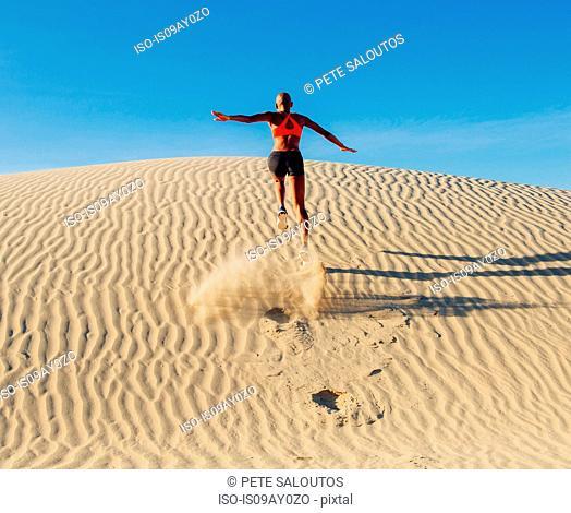 Runner sprinting in desert, Death Valley, California, USA