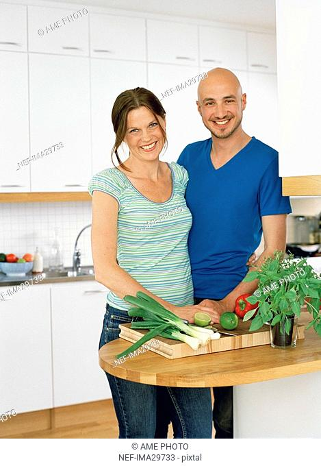 Portrait of a man and a woman in a kitchen