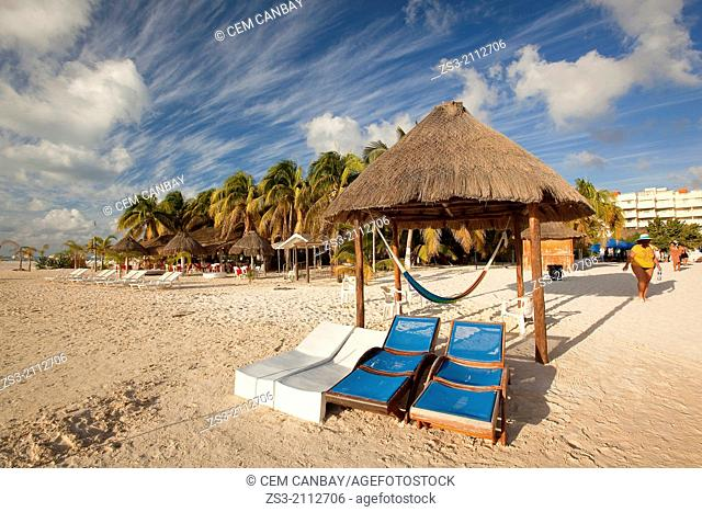 Thatched umbrellas, sunbeds and tourists at the sandy beach, Isla Mujeres, Cancun, Quintana Roo, Yucatan Province, Mexico, North America