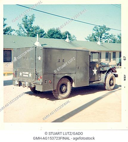 Candid photo of United States Army military vehicle parked in front of a barracks in Vietnam during the Vietnam War, May, 1967. ()