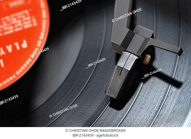 Turntable playing an LP record