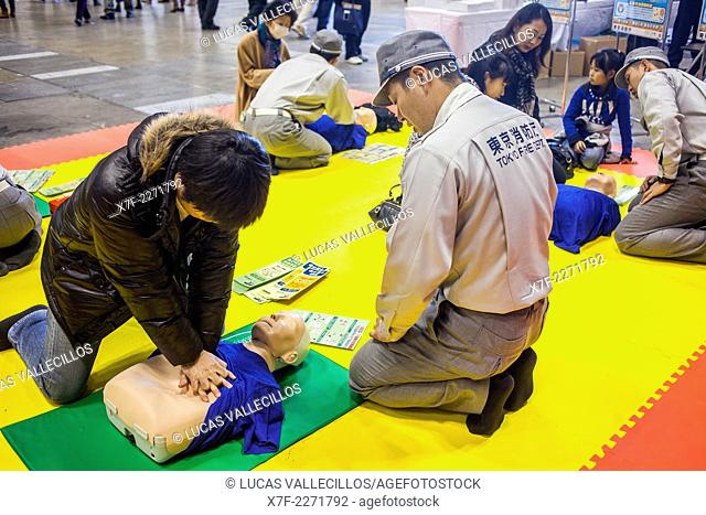 Training first aid, during Dezomeshiki or New Year parade by the Tokyo Fire Department, Tokyo, Japan